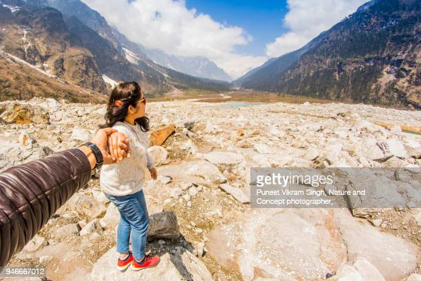 adventure couple in mountains - human body part stock pictures, royalty-free photos & images