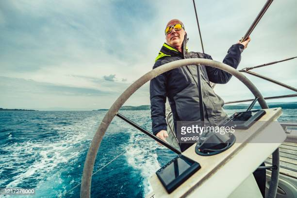adventure man sailing on aadriatic sea - team captain stock pictures, royalty-free photos & images