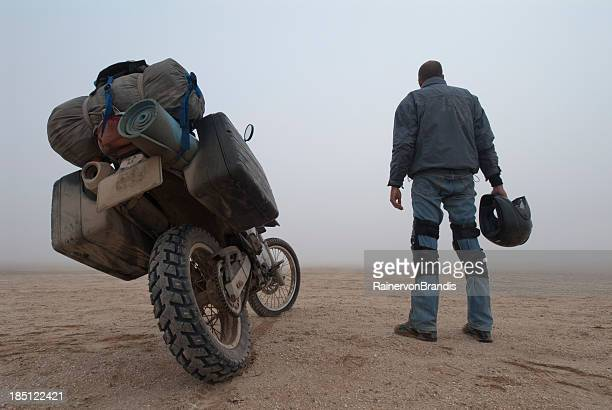 adventure motorcyclist in the fog