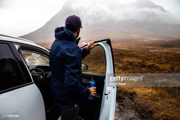 adventure off road with car in the scottish highlands with rain. - rear view stock pictures, royalty-free photos & images