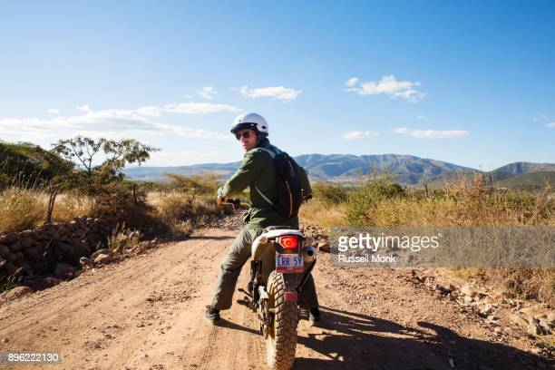 adventure on a motorbike - looking over shoulder stock pictures, royalty-free photos & images