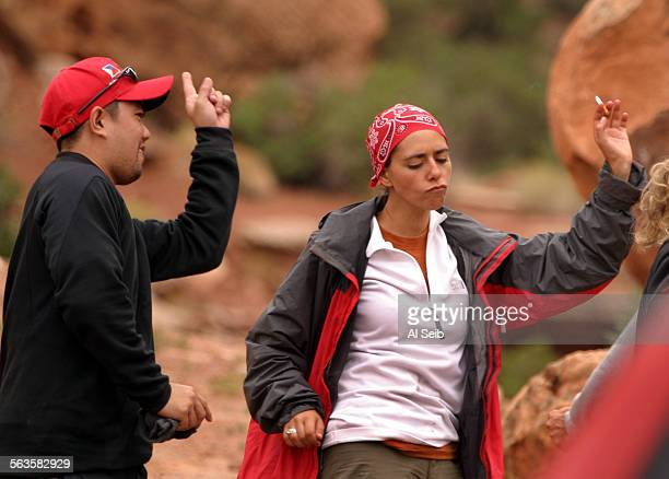 MOAB UTAH Adventure race in utah Participants in the Marlboro Adventure Team event near Moab Utah share a cigarette and dance after a hike through...