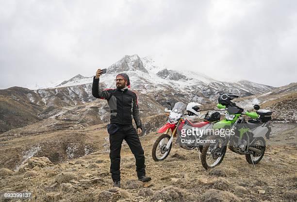 Adventure rider taking selfie