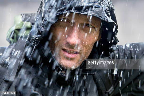 adventurer in typhoon - raincoat stock pictures, royalty-free photos & images