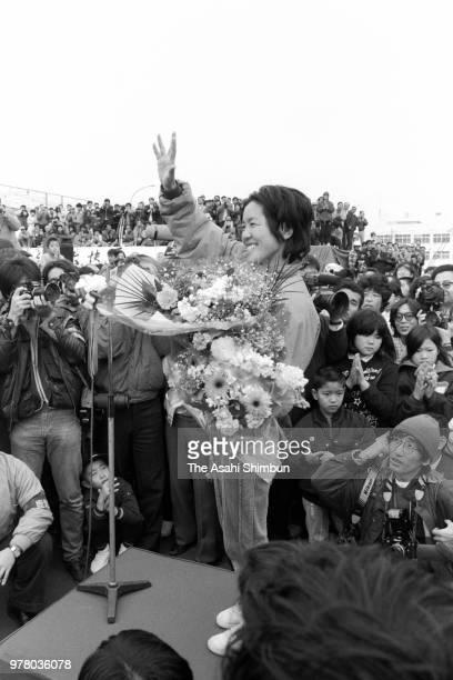 Adventurer Kyoko Imakyure celebrates after her transpacific sailing on December 31 1988 in Kagoshima Japan