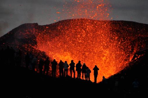 Adventurers witnessing a Volcanic Eruption 509661971