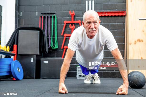adventures of an active australian senior male, working out in the gym - disruptagingcollection stock photos and pictures