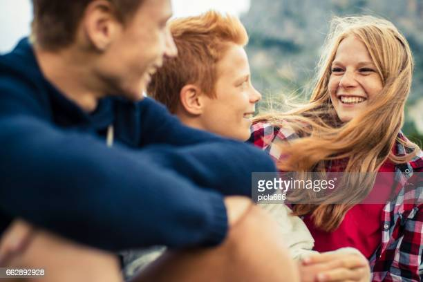 adventures on the dolomites: brothers and sister together - teenager stock pictures, royalty-free photos & images