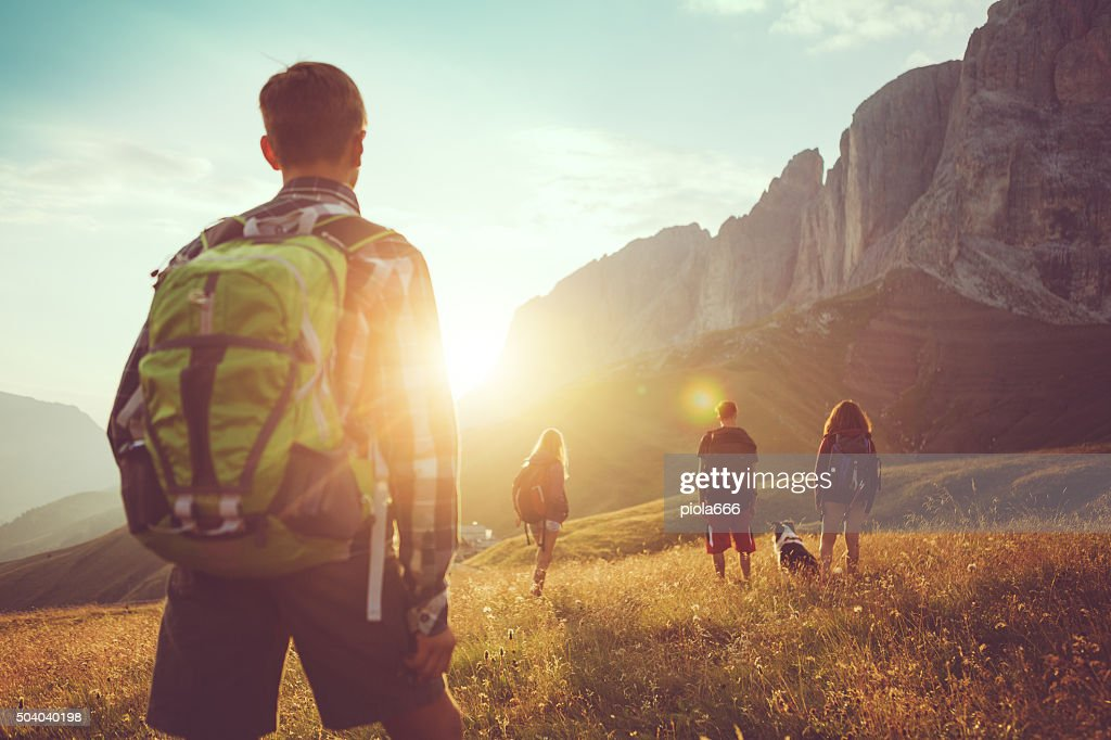 Adventures on the Dolomites: friends hiking with dog : Stock Photo