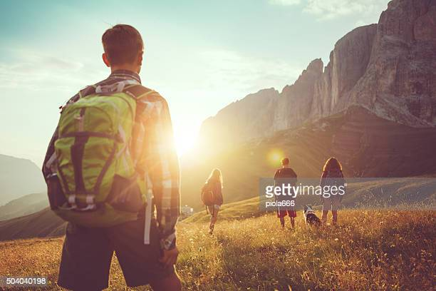 adventures on the dolomites: friends hiking with dog - outdoor pursuit stock pictures, royalty-free photos & images