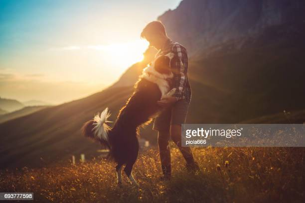 adventures on the dolomites: friends hiking with dog - border collie stock pictures, royalty-free photos & images