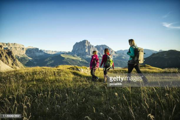 adventures on the dolomites: group of women hiking - dolomiti foto e immagini stock