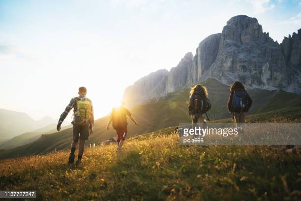 adventures on the dolomites: teenagers hiking with dog - backpacker stock pictures, royalty-free photos & images
