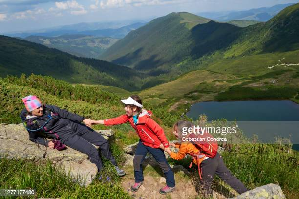 adventures on the mountain: family together hiking with two children. - romania stock pictures, royalty-free photos & images