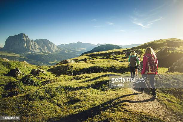 adventures on the mountain: women together - european alps stock photos and pictures