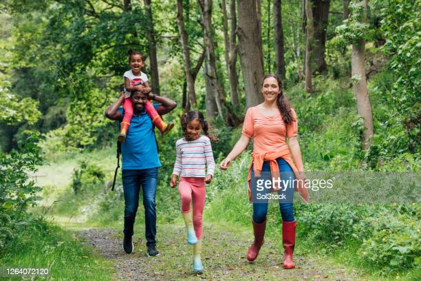 adventures with mum and dad - multiracial group stock pictures, royalty-free photos & images