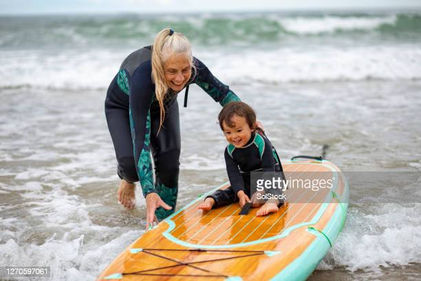 adventurous grandmother - bonding stock pictures, royalty-free photos & images