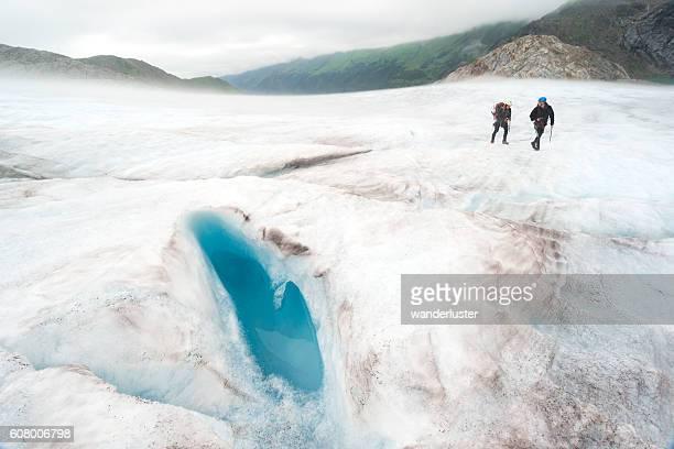 Adventurous hikers explore icy landscape