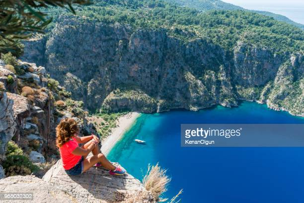 adventurous. looking down from the cliff. - mugla province stock pictures, royalty-free photos & images
