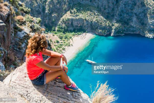 adventurous. looking down from the cliff. - passenger craft stock pictures, royalty-free photos & images