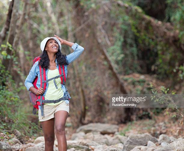Adventurous tourist woman enjoying nature.