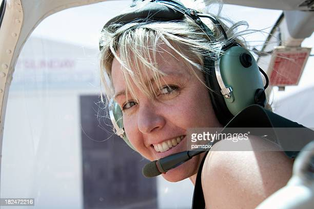Adventurous Woman in Helicopter wearing headset
