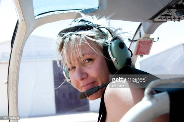Adventurous Woman in Helicopter with headset