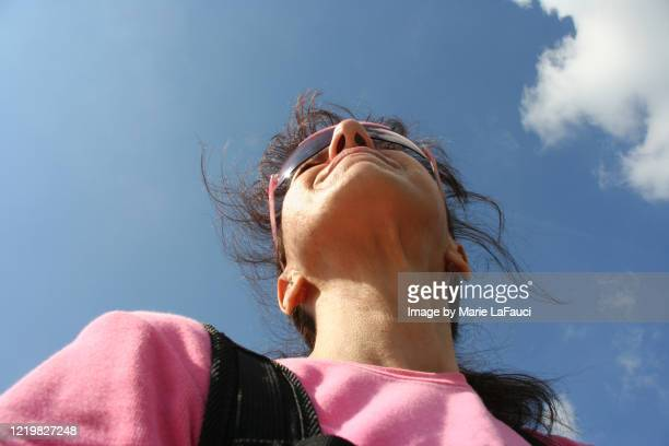 adventurous woman outdoors looking forward - marie lafauci stock pictures, royalty-free photos & images