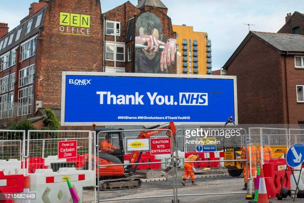 A advert thanking the NHS is displayed above a construction site in central Manchester on March 30 2020 in Manchester United Kingdom The Coronavirus...