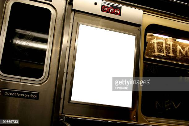 advertise here billboard in white on subway - underground stock photos and pictures