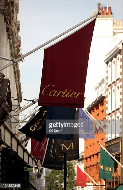 Advertisement flags for luxury goods retailers fly on New Bond Street in Mayfair which is the most expensive avenue in Europe for retail rents on...