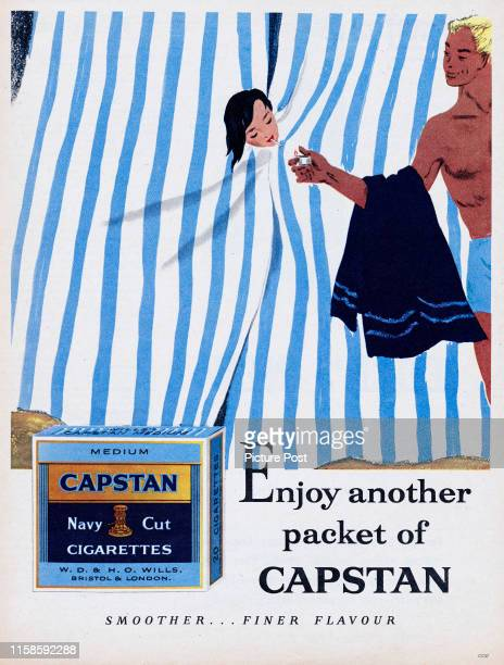 Advertisement for Capstan Navy Cut cigarettes showing a man lighting the cigarette of a woman inside a beach hut Original Publication Picture Post Ad...