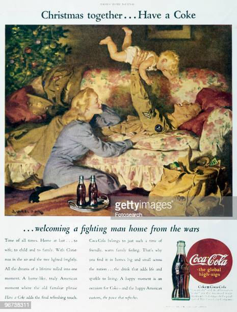 Advertisement for CocaCola circa 1945 Illustration of laughing soldier lying on sofa holding baby in air with mother sitting on floor beside them two...