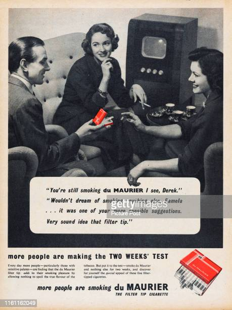 Advertisement for du Maurier cigarettes showing a group of friends watching television with a cup of tea and a cigarette Original Publication Picture...