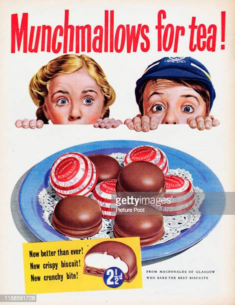 Advertisement for Macdonald's Munchmallow milk chocolate biscuits showing a boy and girl with the caption 'Munchmallows for tea' Original Publication...
