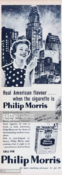 Advertisement for Philip Morris Cigarettes showing a young woman smoking with a backdrop of the New York City skyline Original Publication Picture...