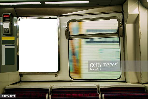 advertisement panel inside subway train - subway train stock pictures, royalty-free photos & images
