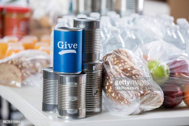 advertisement to give to local food bank - charitable donation stock pictures, royalty-free photos & images