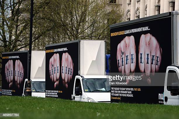 Advertisement vans with the words 'Liar Liar' emblazoned on the side drive around Parliament Square on April 16 2015 in London England The vans were...
