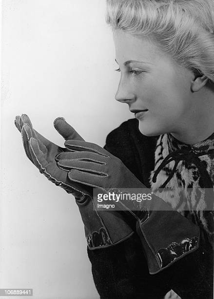 Advertisement with Leather Gloves The picture shows a model with dark leather gloves Photograph Around 1930