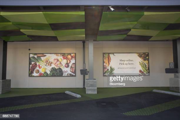 Advertisements are displayed above parking spots at an AmazonFresh Pickup location in Seattle Washington US on Friday May 26 2017 Amazoncom Inc...