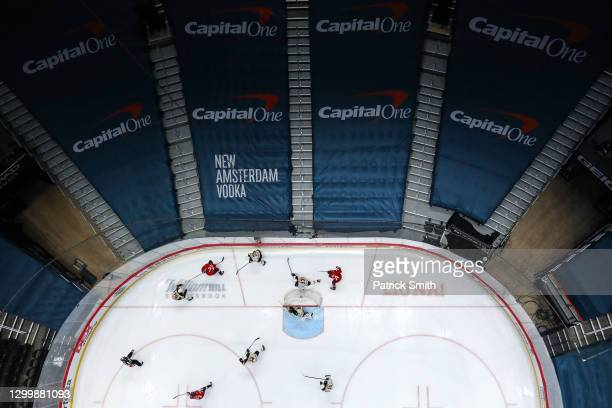 Advertisements cover spectators seating as the Boston Bruins play against the Washington Capitals during the first period at Capital One Arena on...