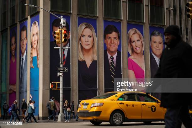 Advertisements featuring Fox News personalities, including Tucker Carlson, adorn the front of the News Corporation building, March 13, 2019 in New...