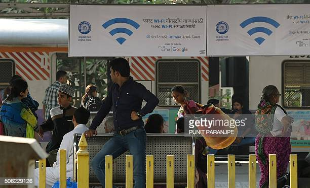 Advertisements for a new free WiFi Internet service hang in Mumbai's central railway station on January 22 2016 Indian Railways' RailTel has...
