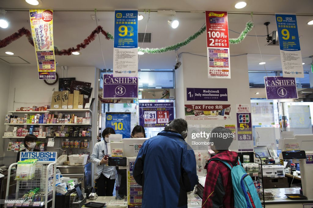 Advertisements for Ant Financial Services Group's Alipay, an affiliate of Alibaba Group Holding Ltd., hang above cashier counters at a Takeya Co. Ueno Select shop in Tokyo, Japan, on Saturday, Dec. 9, 2017. Ant Financial and its strategic partners outside China should be able to nearly double users of their payments systems in coming years, Ant's overseas operations president Douglas Feagin said on Nov. 14. Photographer: Shiho Fukada/Bloomberg via Getty Images
