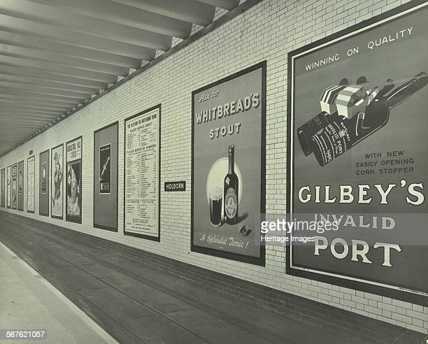 Advertisements for beer and port Holborn Underground Tram Station London 1931 Advertising posters on the southbound platform at Holborn Underground...