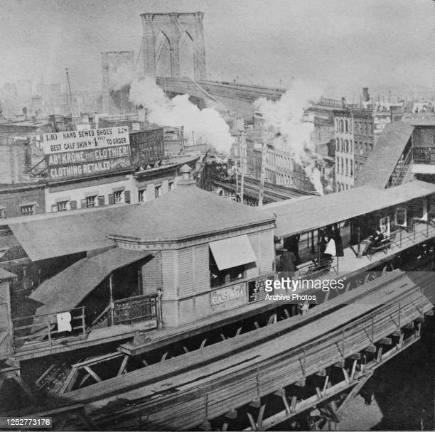 Advertisements for Castoria and O & O Tea at an elevated railway station on the Brooklyn end of Brooklyn Bridge in New York City, 1890.