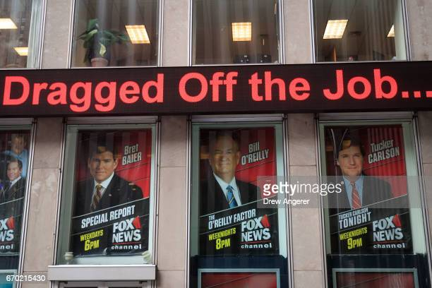 Advertisements for Fox News personalities including Bill O'Reilly stand in the windows outside of the News Corp and Fox News headquarters in Midtown...