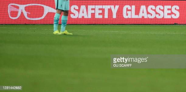 Advertisements for Personal Protective Equipment are displayed on LED boards during the English Premier League football match between Sheffield...