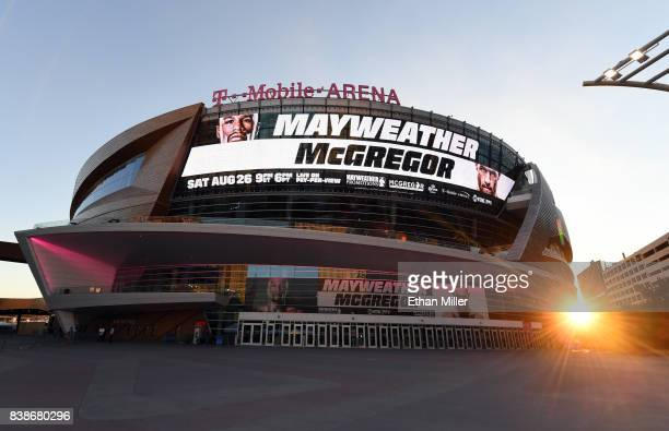 Advertisements for the bout between boxer Floyd Mayweather Jr and UFC lightweight champion Conor McGregor are displayed on the side of TMobile Arena...